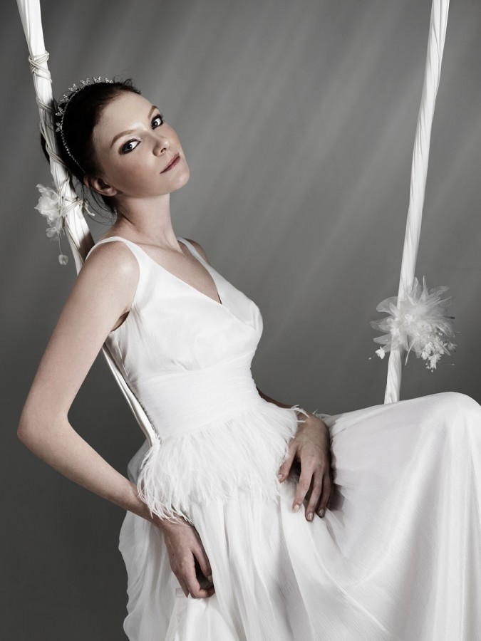 V-neck wedding dress with feather