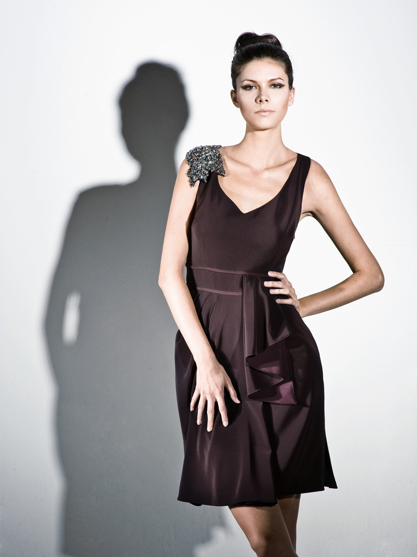 Asymmetric dress with beaded motif